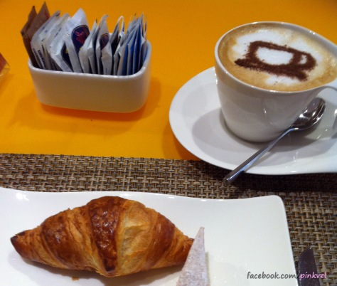 Italian breakfast: Cappuccino and croissant